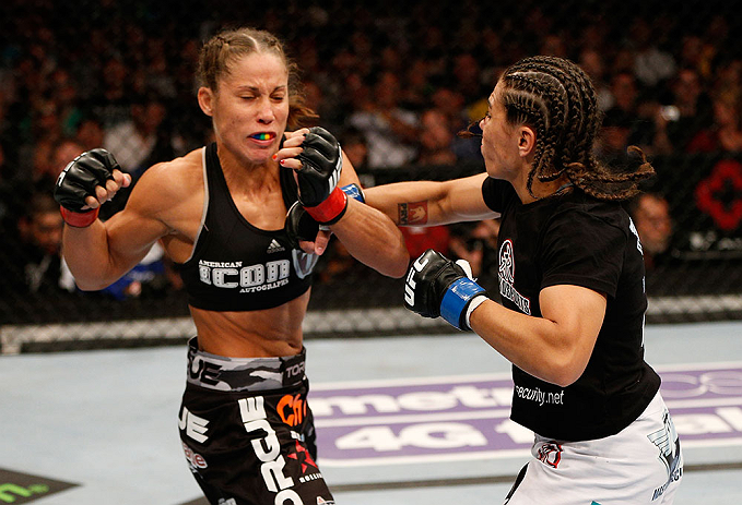 SEATTLE, WA - JULY 27: (R-L) Jessica Andrade punches Liz Carmouche in their bantamweight bout during the UFC on FOX event at Key Arena on July 27, 2013 in Seattle, Washington. (Photo by Josh Hedges/Zuffa LLC/Zuffa LLC via Getty Images) *** Local Caption *** Liz Carmouche; Jessica Andrade