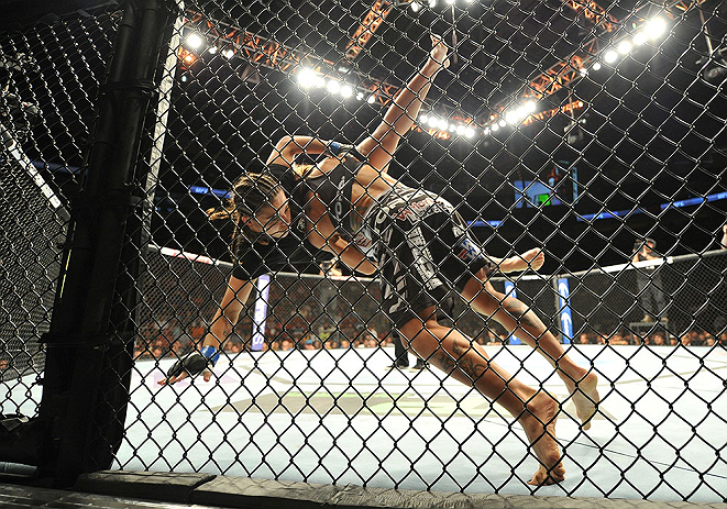SEATTLE, WA - JULY 27: Liz Carmouche (right) slams Jessica Andrade during their bantamweight bout during the UFC on FOX event at Key Arena on July 27, 2013 in Seattle, Washington. (Photo by Jeff Bottari/Zuffa LLC/Zuffa LLC via Getty Images) *** Local Caption *** Liz Carmouche; Jessica Andrade