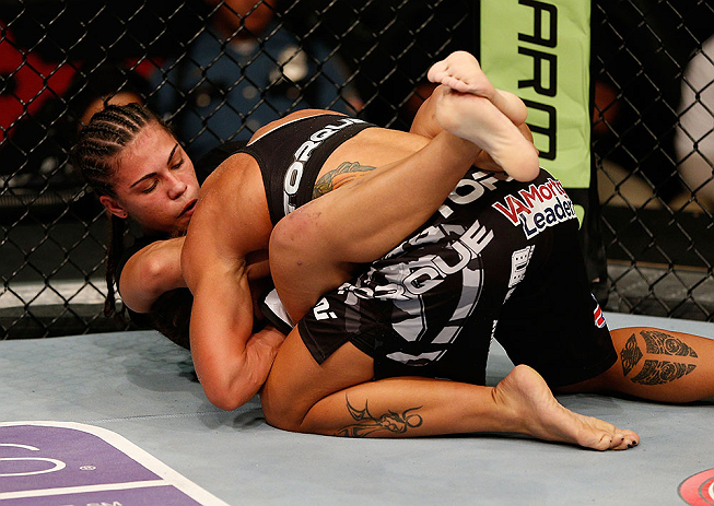 SEATTLE, WA - JULY 27: Jessica Andrade (left) attempts to submit Liz Carmouche in their bantamweight bout during the UFC on FOX event at Key Arena on July 27, 2013 in Seattle, Washington. (Photo by Josh Hedges/Zuffa LLC/Zuffa LLC via Getty Images) *** Local Caption *** Liz Carmouche; Jessica Andrade