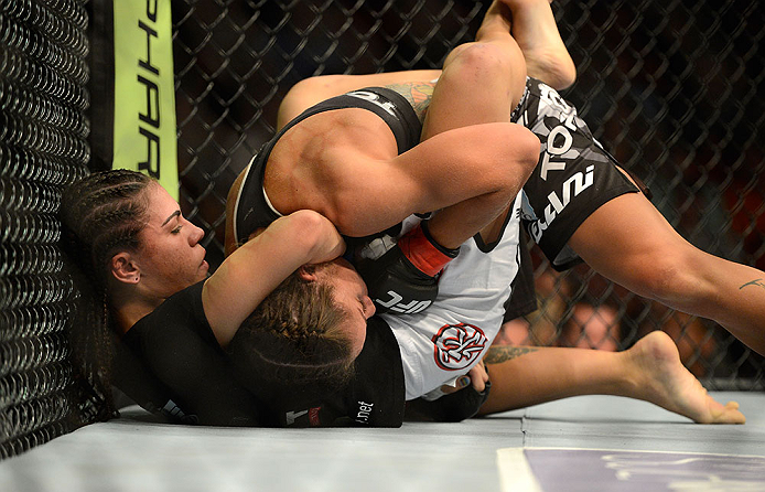 SEATTLE, WA - JULY 27: Jessica Andrade (left) attempts to submit Liz Carmouche in their bantamweight bout during the UFC on FOX event at Key Arena on July 27, 2013 in Seattle, Washington. (Photo by Jeff Bottari/Zuffa LLC/Zuffa LLC via Getty Images) *** Local Caption *** Liz Carmouche; Jessica Andrade