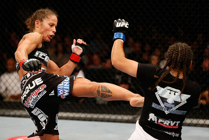 SEATTLE, WA - JULY 27: (L-R) Liz Carmouche kicks Jessica Andrade in their bantamweight bout during the UFC on FOX event at Key Arena on July 27, 2013 in Seattle, Washington. (Photo by Josh Hedges/Zuffa LLC/Zuffa LLC via Getty Images) *** Local Caption *** Liz Carmouche; Jessica Andrade