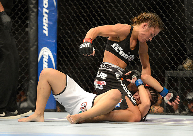 SEATTLE, WA - JULY 27: Liz Carmouche (top) punches Jessica Andrade in their bantamweight bout during the UFC on FOX event at Key Arena on July 27, 2013 in Seattle, Washington. (Photo by Jeff Bottari/Zuffa LLC/Zuffa LLC via Getty Images) *** Local Caption *** Liz Carmouche; Jessica Andrade