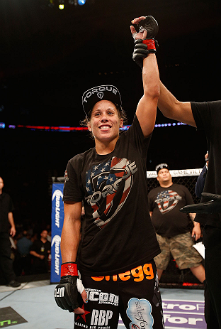 SEATTLE, WA - JULY 27: Liz Carmouche reacst to her victory over Jessica Andrade in their bantamweight bout during the UFC on FOX event at Key Arena on July 27, 2013 in Seattle, Washington. (Photo by Josh Hedges/Zuffa LLC/Zuffa LLC via Getty Images) *** Local Caption *** Liz Carmouche