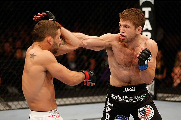 SACRAMENTO, CA - DECEMBER 14:  (R-L) Nik Lentz punches Chad Mendes in their featherweight bout during the UFC on FOX event at Sleep Train Arena on December 14, 2013 in Sacramento, California. (Photo by Josh Hedges/Zuffa LLC/Zuffa LLC via Getty Images) *** Local Caption *** Chad Mendes; Nik Lentz
