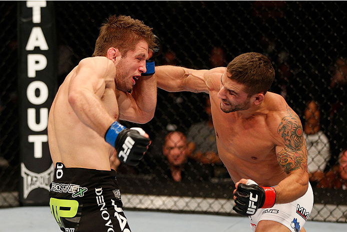 SACRAMENTO, CA - DECEMBER 14:  (R-L) Chad Mendes punches Nik Lentz in their featherweight bout during the UFC on FOX event at Sleep Train Arena on December 14, 2013 in Sacramento, California. (Photo by Josh Hedges/Zuffa LLC/Zuffa LLC via Getty Images) *** Local Caption *** Chad Mendes; Nik Lentz