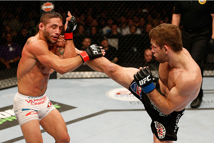 SACRAMENTO, CA - DECEMBER 14:  (R-L) Nik Lentz kicks Chad Mendes in their featherweight bout during the UFC on FOX event at Sleep Train Arena on December 14, 2013 in Sacramento, California. (Photo by Josh Hedges/Zuffa LLC/Zuffa LLC via Getty Images) *** Local Caption *** Chad Mendes; Nik Lentz