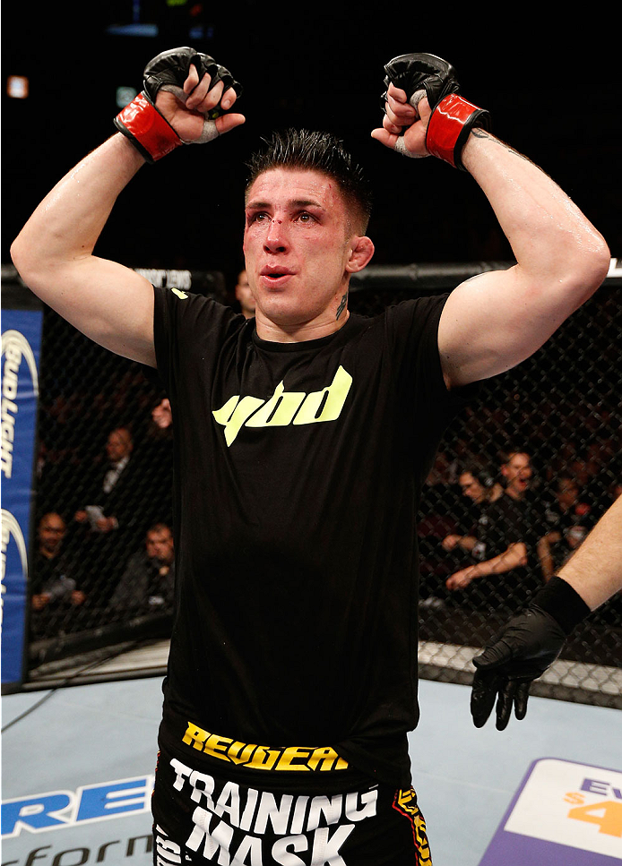 MANCHESTER, ENGLAND - OCTOBER 26:  Norman Parke reacts after his decision victory over Jon Tuck in their lightweight bout during the UFC Fight Night event at Phones 4 U Arena on October 26, 2013 in Manchester, England. (Photo by Josh Hedges/Zuffa LLC/Zuffa LLC via Getty Images)