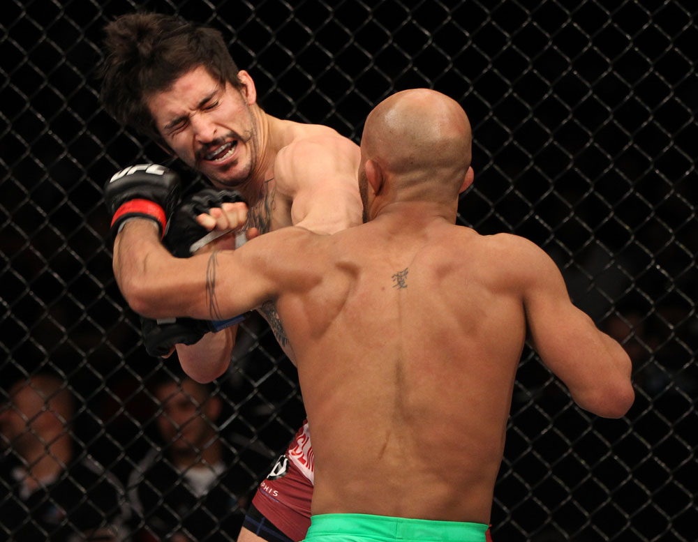SYDNEY, AUSTRALIA - MARCH 03:  (R-L) Demetrious Johnson punches Ian McCall in a flyweight bout during the UFC on FX event at Allphones Arena on March 3, 2012 in Sydney, Australia.  (Photo by Josh Hedges/Zuffa LLC/Zuffa LLC via Getty Images) *** Local Caption *** Demetrious Johnson; Ian McCall