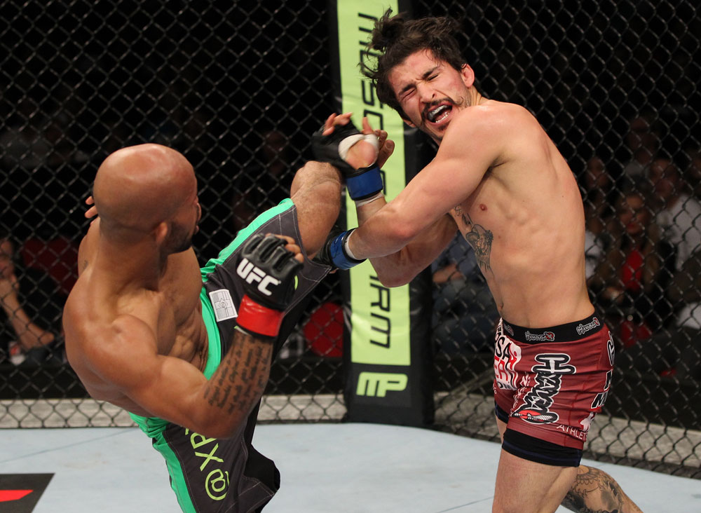 SYDNEY, AUSTRALIA - MARCH 03:  (L-R) Demetrious Johnson kicks Ian McCall in a flyweight bout during the UFC on FX event at Allphones Arena on March 3, 2012 in Sydney, Australia.  (Photo by Josh Hedges/Zuffa LLC/Zuffa LLC via Getty Images) *** Local Caption *** Demetrious Johnson; Ian McCall