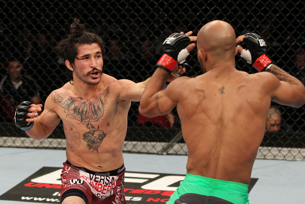 SYDNEY, AUSTRALIA - MARCH 03:  (L-R) Ian McCall punches Demetrious Johnson in a flyweight bout during the UFC on FX event at Allphones Arena on March 3, 2012 in Sydney, Australia.  (Photo by Josh Hedges/Zuffa LLC/Zuffa LLC via Getty Images) *** Local Caption *** Demetrious Johnson; Ian McCall