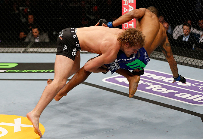 LONDON, ENGLAND - FEBRUARY 16:  (L-R) Gunnar Nelson takes down Jorge Santiago in their welterweight fight during the UFC on Fuel TV event on February 16, 2013 at Wembley Arena in London, England.  (Photo by Josh Hedges/Zuffa LLC/Zuffa LLC via Getty Images)