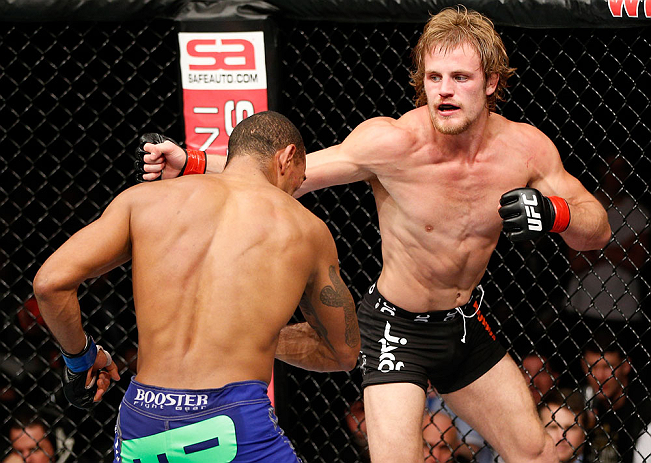 LONDON, ENGLAND - FEBRUARY 16:  (R-L) Gunnar Nelson punches Jorge Santiago in their welterweight fight during the UFC on Fuel TV event on February 16, 2013 at Wembley Arena in London, England.  (Photo by Josh Hedges/Zuffa LLC/Zuffa LLC via Getty Images)