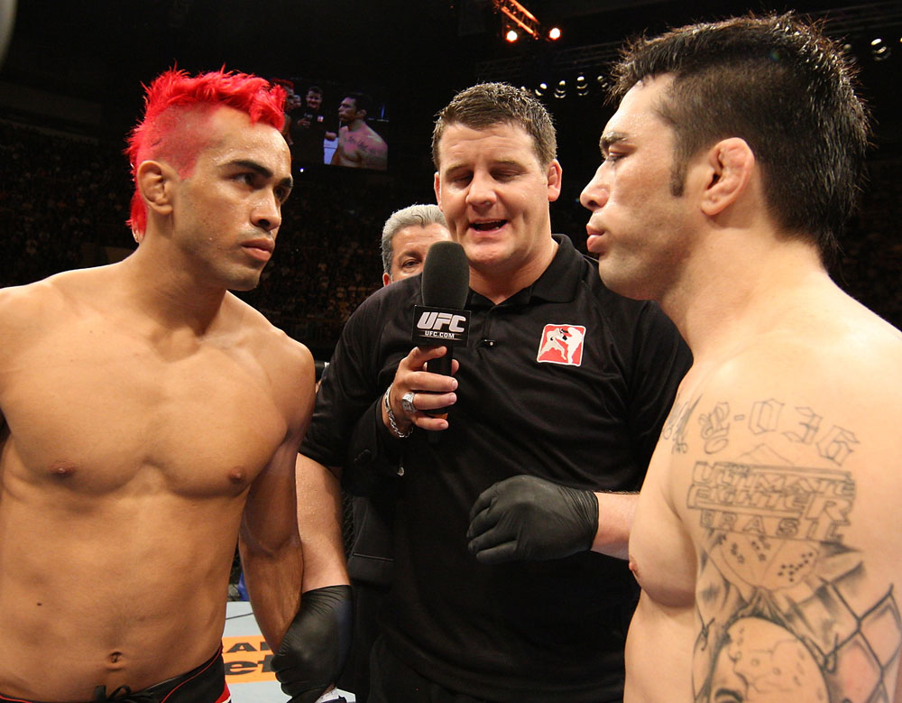 "BELO HORIZONTE, BRAZIL - JUNE 23:   (L-R) Opponents Godofredo Pepey and Rony ""Jason"" Mariano Bezerra receive final instructions from the referee before their UFC 147 featherweight bout at Estadio Jornalista Felipe Drummond on June 23, 2012 in Belo Horizonte, Brazil.  (Photo by Josh Hedges/Zuffa LLC/Zuffa LLC via Getty Images)"