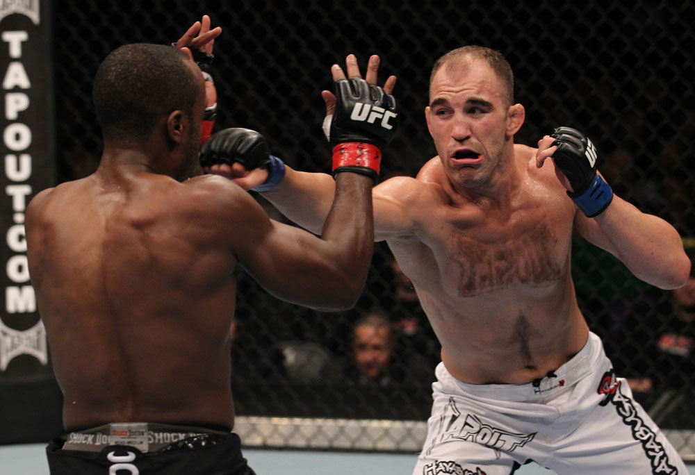 TORONTO, ON - DECEMBER 10:  Brian Ebersole (white shorts) punches Claude Patrick during the UFC 140 event at Air Canada Centre on December 10, 2011 in Toronto, Ontario, Canada.  (Photo by Nick Laham/Zuffa LLC/Zuffa LLC via Getty Images)