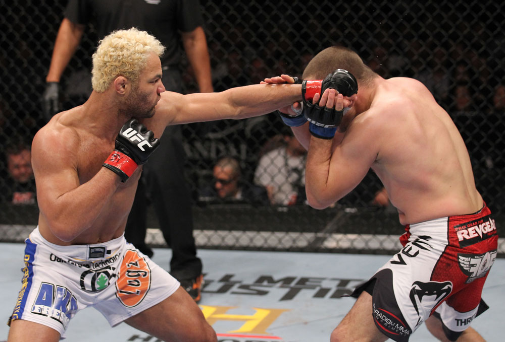 LAS VEGAS, NV - FEBRUARY 04:  Josh Koscheck (left) punches Mike Pierce during the UFC 143 event at Mandalay Bay Events Center on February 4, 2012 in Las Vegas, Nevada.  (Photo by Nick Laham/Zuffa LLC/Zuffa LLC via Getty Images) *** Local Caption *** Josh Koscheck; Mike Pierce