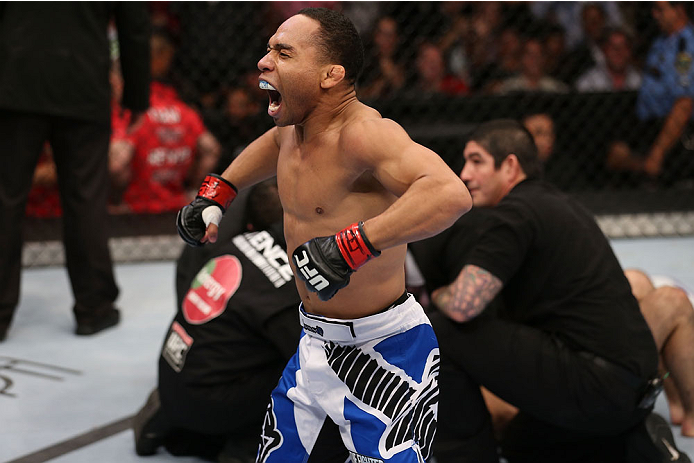 HOUSTON, TEXAS - OCTOBER 19:  (L-R) John Dodson celebrates after defeating Darrell Montague by knockout in their UFC flyweight bout at the Toyota Center on October 19, 2013 in Houston, Texas. (Photo by Nick Laham/Zuffa LLC/Zuffa LLC via Getty Images)