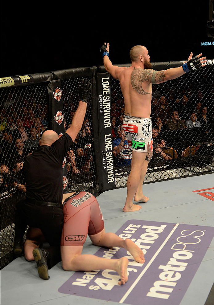 LAS VEGAS, NV - DECEMBER 28:  Travis Browne (right) reacts to his victory over Josh Barnett in their heavyweight bout during the UFC 168 event at the MGM Grand Garden Arena on December 28, 2013 in Las Vegas, Nevada. (Photo by Donald Miralle/Zuffa LLC/Zuffa LLC via Getty Images) *** Local Caption *** Josh Barnett; Travis Browne