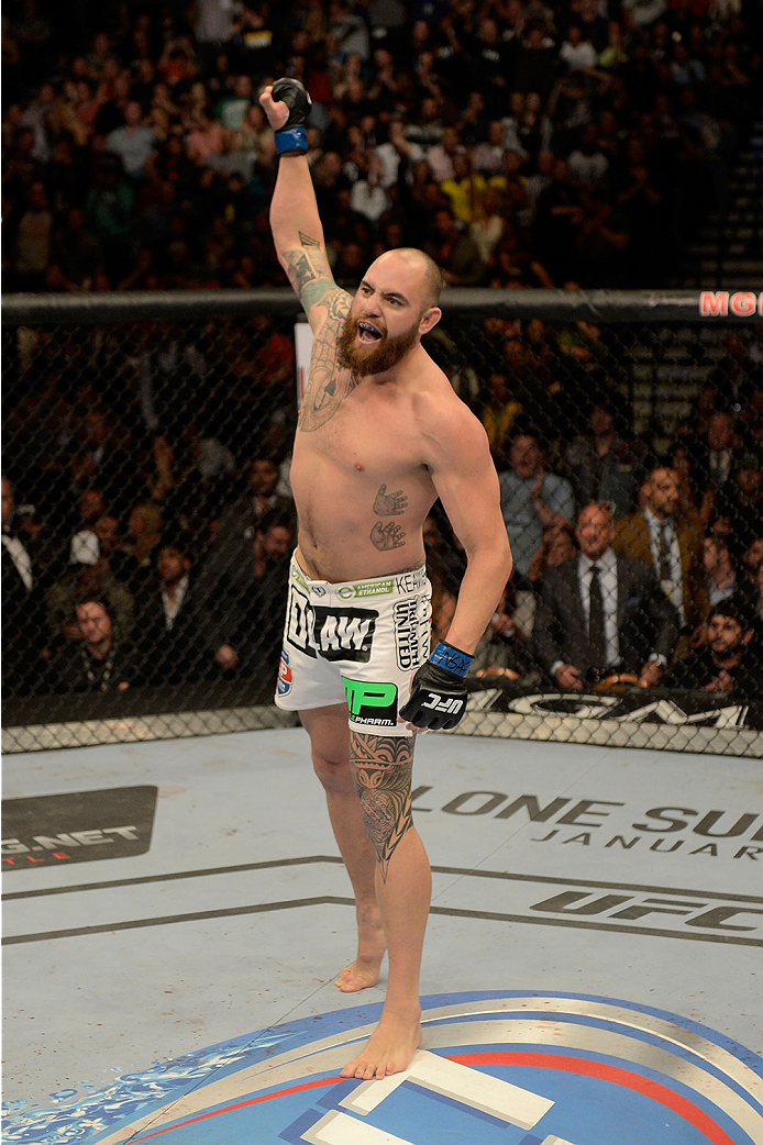 LAS VEGAS, NV - DECEMBER 28:  Travis Browne reacts to his victory over Josh Barnett in their heavyweight bout during the UFC 168 event at the MGM Grand Garden Arena on December 28, 2013 in Las Vegas, Nevada. (Photo by Donald Miralle/Zuffa LLC/Zuffa LLC via Getty Images) *** Local Caption *** Travis Browne