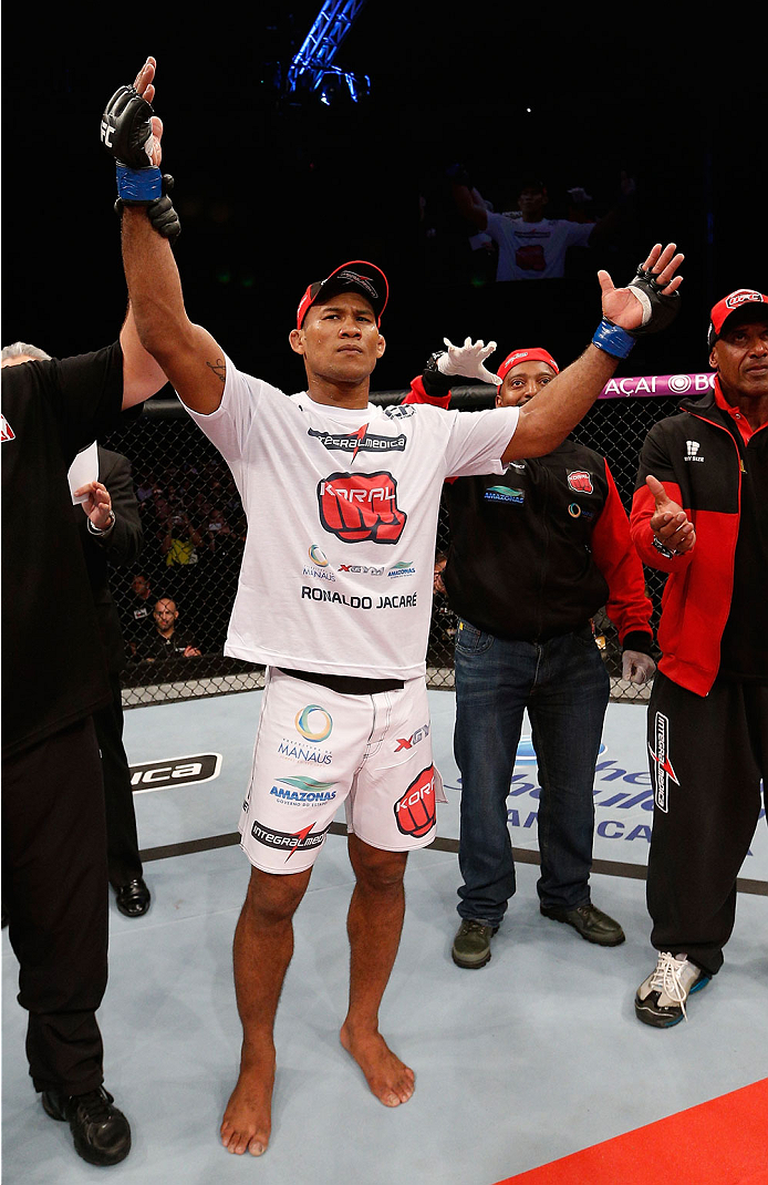 "BELO HORIZONTE, BRAZIL - SEPTEMBER 04:  Ronaldo ""Jacare"" Souza reacts after knocking out Yushin Okami in their middleweight fight during the UFC on FOX Sports 1 event at Mineirinho Arena on September 4, 2013 in Belo Horizonte, Brazil. (Photo by Josh Hedges/Zuffa LLC/Zuffa LLC via Getty Images)"