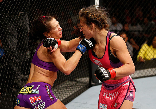 LAS VEGAS, NV - APRIL 13:   (R-L) Miesha Tate punches Cat Zingano in their bantamweight fight at the Mandalay Bay Events Center  on April 13, 2013 in Las Vegas, Nevada.  (Photo by Josh Hedges/Zuffa LLC/Zuffa LLC via Getty Images)  *** Local Caption *** Miesha Tate; Cat Zingano