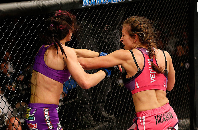 LAS VEGAS, NV - APRIL 13:   (R-L) Miesha Tate punches in their bantamweight fight at the Mandalay Bay Events Center  on April 13, 2013 in Las Vegas, Nevada.  (Photo by Josh Hedges/Zuffa LLC/Zuffa LLC via Getty Images)  *** Local Caption *** Miesha Tate; Cat Zingano