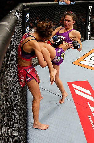 LAS VEGAS, NV - APRIL 13:   (R-L) Cat Zingano knees Miesha Tate in their bantamweight fight at the Mandalay Bay Events Center  on April 13, 2013 in Las Vegas, Nevada.  (Photo by Josh Hedges/Zuffa LLC/Zuffa LLC via Getty Images)  *** Local Caption *** Miesha Tate; Cat Zingano