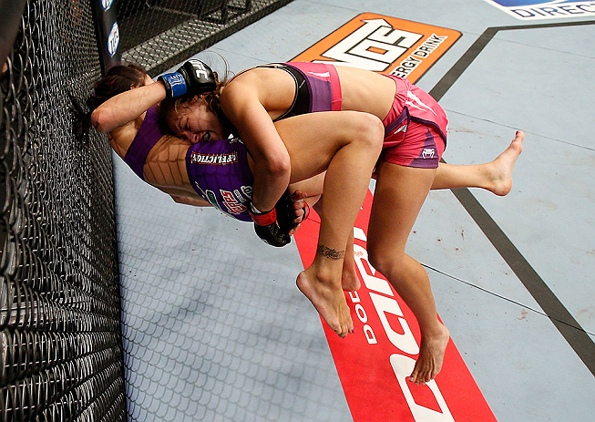 LAS VEGAS, NV - APRIL 13:   Miesha Tate (top) takes down Cat Zingano in their bantamweight fight at the Mandalay Bay Events Center  on April 13, 2013 in Las Vegas, Nevada.  (Photo by Josh Hedges/Zuffa LLC/Zuffa LLC via Getty Images)  *** Local Caption *** Miesha Tate; Cat Zingano