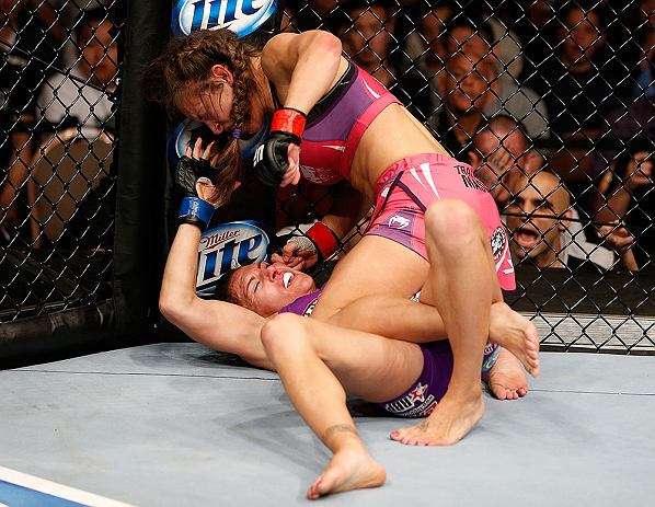 LAS VEGAS, NV - APRIL 13:   Miesha Tate (top) punches Cat Zingano in their bantamweight fight at the Mandalay Bay Events Center  on April 13, 2013 in Las Vegas, Nevada.  (Photo by Josh Hedges/Zuffa LLC/Zuffa LLC via Getty Images)  *** Local Caption *** Miesha Tate; Cat Zingano