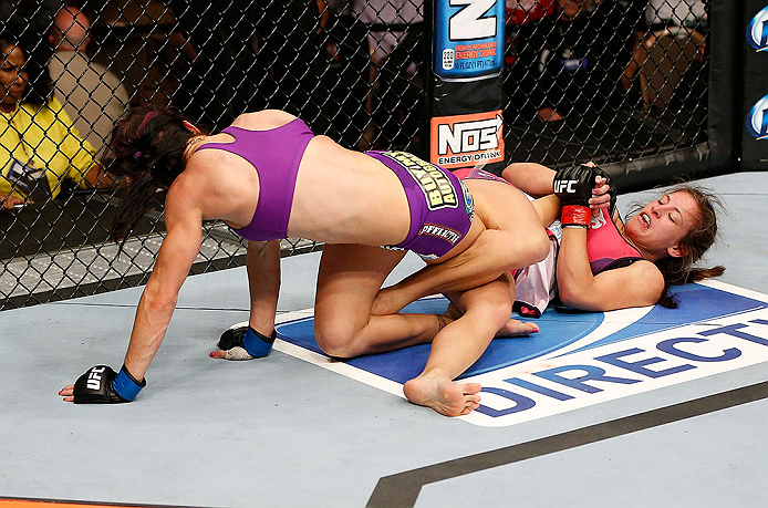 LAS VEGAS, NV - APRIL 13:   Miesha Tate (right) attempts to submit Cat Zingano in their bantamweight fight at the Mandalay Bay Events Center  on April 13, 2013 in Las Vegas, Nevada.  (Photo by Josh Hedges/Zuffa LLC/Zuffa LLC via Getty Images)  *** Local Caption *** Miesha Tate; Cat Zingano