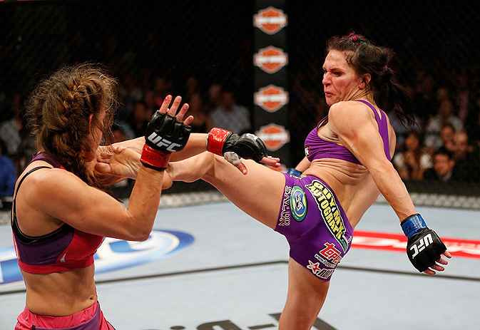 LAS VEGAS, NV - APRIL 13:   (R-L) Cat Zingano kicks Miesha Tate in their bantamweight fight at the Mandalay Bay Events Center  on April 13, 2013 in Las Vegas, Nevada.  (Photo by Josh Hedges/Zuffa LLC/Zuffa LLC via Getty Images)  *** Local Caption *** Miesha Tate; Cat Zingano