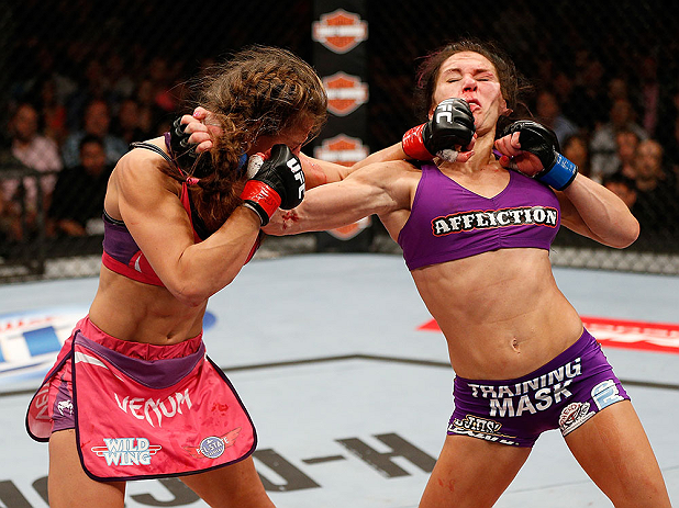 LAS VEGAS, NV - APRIL 13:   (L-R) Miesha Tate and Cat Zingano exchange punches in their bantamweight fight at the Mandalay Bay Events Center  on April 13, 2013 in Las Vegas, Nevada.  (Photo by Josh Hedges/Zuffa LLC/Zuffa LLC via Getty Images)  *** Local Caption *** Miesha Tate; Cat Zingano