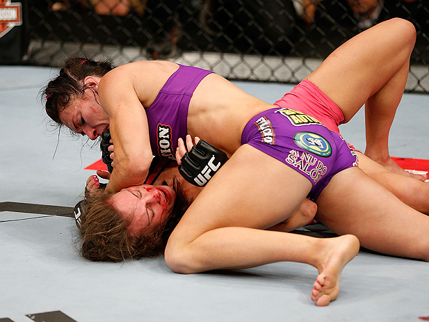 LAS VEGAS, NV - APRIL 13:   Cat Zingano (top) elbows Miesha Tate in their bantamweight fight at the Mandalay Bay Events Center  on April 13, 2013 in Las Vegas, Nevada.  (Photo by Josh Hedges/Zuffa LLC/Zuffa LLC via Getty Images)  *** Local Caption *** Miesha Tate; Cat Zingano