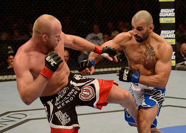 LAS VEGAS, NV - DECEMBER 29:  (L-R) Tim Boetsch kicks Constantinos Philippou during their middleweight fight at UFC 155 on December 29, 2012 at MGM Grand Garden Arena in Las Vegas, Nevada. (Photo by Donald Miralle/Zuffa LLC/Zuffa LLC via Getty Images) *** Local Caption *** Tim Boetsch; Constantinos Philippou