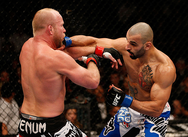 LAS VEGAS, NV - DECEMBER 29:  (R-L) Constantinos Philippou punches Tim Boetsch during their middleweight fight at UFC 155 on December 29, 2012 at MGM Grand Garden Arena in Las Vegas, Nevada. (Photo by Josh Hedges/Zuffa LLC/Zuffa LLC via Getty Images) *** Local Caption *** Tim Boetsch; Constantinos Philippou