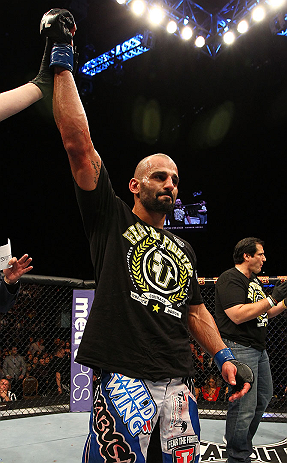 LAS VEGAS, NV - DECEMBER 29:  Constantinos Philippou reacts to being declared the winner against Tim Boetsch after their middleweight fight at UFC 155 on December 29, 2012 at MGM Grand Garden Arena in Las Vegas, Nevada. (Photo by Josh Hedges/Zuffa LLC/Zuffa LLC via Getty Images) *** Local Caption *** Tim Boetsch; Constantinos Philippou