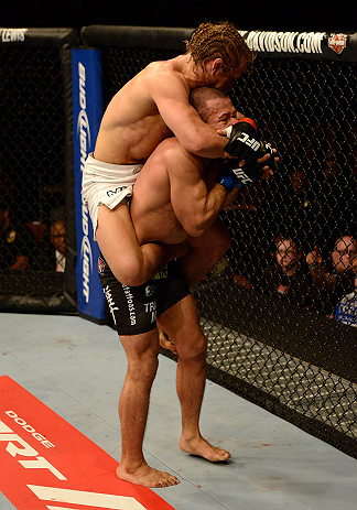 ANAHEIM, CA - FEBRUARY 23:  Urijah Faber (left) attempts to submit Ivan Menjivar in their bantamweight bout during UFC 157 at Honda Center on February 23, 2013 in Anaheim, California.  (Photo by Donald Miralle/Zuffa LLC/Zuffa LLC via Getty Images) *** Local Caption *** Urijah Faber; Ivan Menjivar