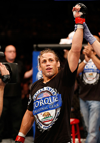 ANAHEIM, CA - FEBRUARY 23:  Urijah Faber is declared the winner over Ivan Menjivar in their bantamweight bout during UFC 157 at Honda Center on February 23, 2013 in Anaheim, California.  (Photo by Josh Hedges/Zuffa LLC/Zuffa LLC via Getty Images) *** Local Caption *** Urijah Faber; Ivan Menjivar