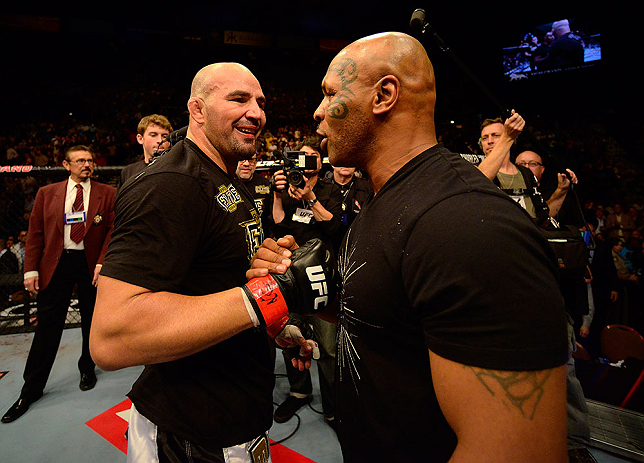 LAS VEGAS, NV - MAY 25:   (R-L) Former professional boxer Mike Tyson congratulates Glover Teixeira in his victory over James Te-Huna in their light heavyweight bout during UFC 160 at the MGM Grand Garden Arena on May 25, 2013 in Las Vegas, Nevada.  (Photo by Donald Miralle/Zuffa LLC/Zuffa LLC via Getty Images)  *** Local Caption *** Glover Teixeira; Mike Tyson