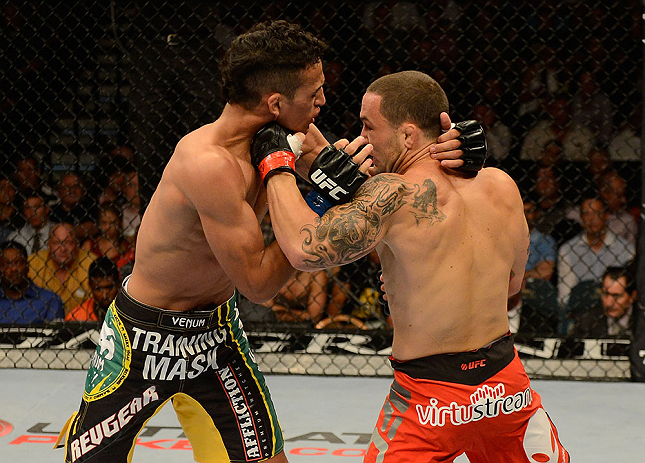 LAS VEGAS, NV - JULY 06:  (R-L) Frankie Edgar punches Charles Oliveira in their featherweight fight during the UFC 162 event inside the MGM Grand Garden Arena on July 6, 2013 in Las Vegas, Nevada.  (Photo by Donald Miralle/Zuffa LLC/Zuffa LLC via Getty Images) *** Local Caption *** Frankie Edgar; Charles Oliveira