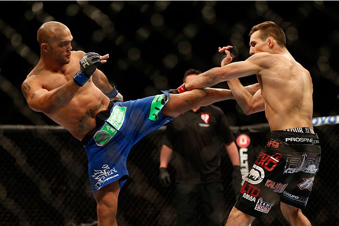 (L-R) Robbie Lawler kicks Rory MacDonald in their welterweight bout during the UFC 167 event inside the MGM Grand Garden Arena on November 16, 2013 in Las Vegas, NV. (Photo by Josh Hedges/Zuffa LLC)