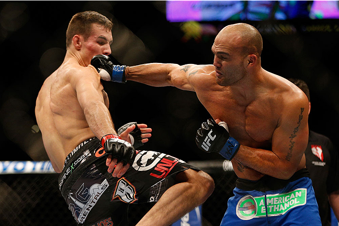 LAS VEGAS, NV - NOVEMBER 16:  (R-L) Robbie Lawler punches Rory MacDonald in their welterweight bout during the UFC 167 event inside the MGM Grand Garden Arena on November 16, 2013 in Las Vegas, Nevada. (Photo by Josh Hedges/Zuffa LLC/Zuffa LLC via Getty Images) *** Local Caption *** Rory MacDonald; Robbie Lawler