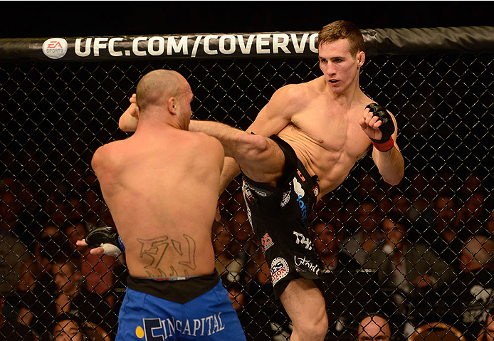 LAS VEGAS, NV - NOVEMBER 16:  (R-L) Rory MacDonald kicks Robbie Lawler in their welterweight bout during the UFC 167 event inside the MGM Grand Garden Arena on November 16, 2013 in Las Vegas, Nevada. (Photo by Donald Miralle/Zuffa LLC/Zuffa LLC via Getty Images) *** Local Caption *** Rory MacDonald; Robbie Lawler