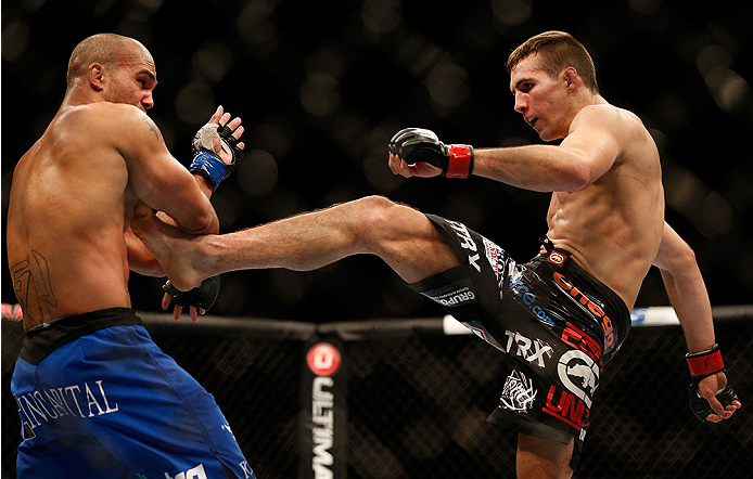 LAS VEGAS, NV - NOVEMBER 16:  (R-L) Rory MacDonald kicks Robbie Lawler in their welterweight bout during the UFC 167 event inside the MGM Grand Garden Arena on November 16, 2013 in Las Vegas, Nevada. (Photo by Josh Hedges/Zuffa LLC/Zuffa LLC via Getty Images) *** Local Caption *** Rory MacDonald; Robbie Lawler