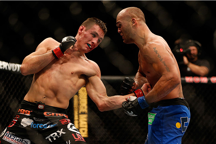 LAS VEGAS, NV - NOVEMBER 16:  (L-R) Rory MacDonald punches Robbie Lawler in their welterweight bout during the UFC 167 event inside the MGM Grand Garden Arena on November 16, 2013 in Las Vegas, Nevada. (Photo by Josh Hedges/Zuffa LLC/Zuffa LLC via Getty Images) *** Local Caption *** Rory MacDonald; Robbie Lawler