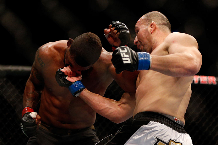 CHICAGO, IL - JANUARY 26:  Glover Teixeira (R) punches Rampage Jackson (L) during their Light Heavyweight Bout part of UFC on FOX at United Center on January 26, 2013 in Chicago, Illinois.  (Photo by Josh Hedges/Zuffa LLC/Zuffa LLC Via Getty Images)