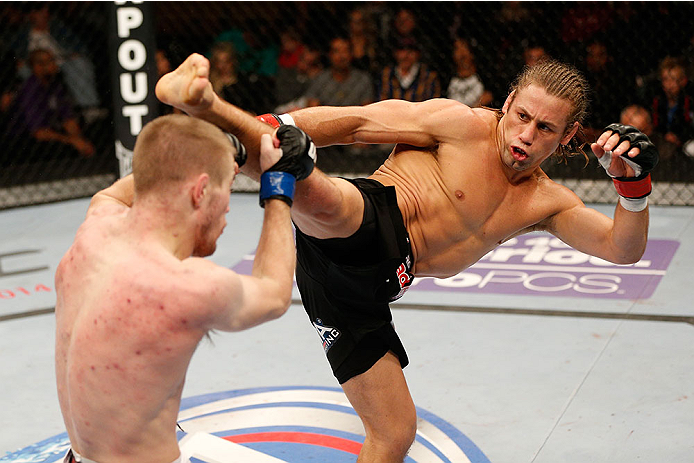 SACRAMENTO, CA - DECEMBER 14:  (R-L) Urijah Faber kicks Michael McDonald in their bantamweight bout during the UFC on FOX event at Sleep Train Arena on December 14, 2013 in Sacramento, California. (Photo by Josh Hedges/Zuffa LLC/Zuffa LLC via Getty Images) *** Local Caption *** Urijah Faber; Michael McDonald