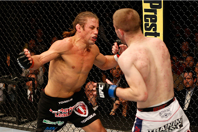 SACRAMENTO, CA - DECEMBER 14: (L-R) Urijah Faber punches Michael McDonald in their bantamweight bout during the UFC on FOX event at Sleep Train Arena on December 14, 2013 in Sacramento, California. (Photo by Josh Hedges/Zuffa LLC/Zuffa LLC via Getty Images)