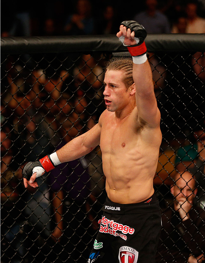 SACRAMENTO, CA - DECEMBER 14:  Urijah Faber reacts to his victory over Michael McDonald in their bantamweight bout during the UFC on FOX event at Sleep Train Arena on December 14, 2013 in Sacramento, California. (Photo by Josh Hedges/Zuffa LLC/Zuffa LLC via Getty Images) *** Local Caption *** Urijah Faber
