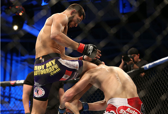 FORT CAMPBELL, KENTUCKY - NOVEMBER 6:  (L-R) Jorge Masvidal knees Rustam Khabilov in their UFC lightweight bout on November 6, 2013 in Fort Campbell, Kentucky. (Photo by Ed Mulholland/Zuffa LLC/Zuffa LLC via Getty Images) *** Local Caption ***Jorge Masvidal; Rustam Khabilov
