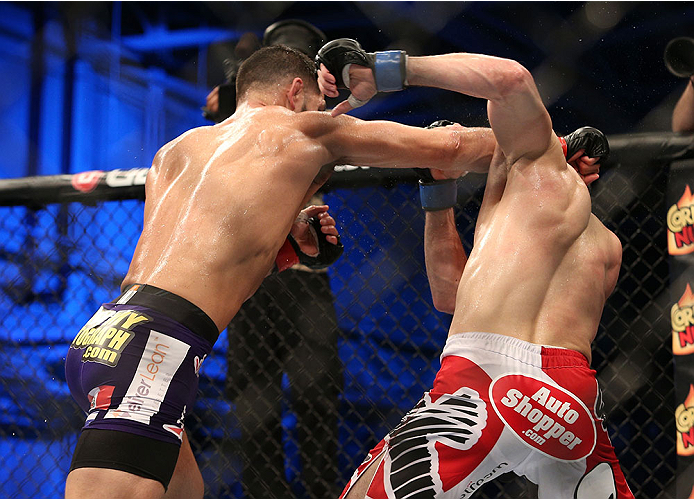 FORT CAMPBELL, KENTUCKY - NOVEMBER 6:  (L-R) Jorge Masvidal punches Rustam Khabilov in their UFC lightweight bout on November 6, 2013 in Fort Campbell, Kentucky. (Photo by Ed Mulholland/Zuffa LLC/Zuffa LLC via Getty Images) *** Local Caption ***Jorge Masvidal; Rustam Khabilov